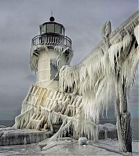 Frozen lighthouse, St. Joseph North Pier, Lake Michigan, North America